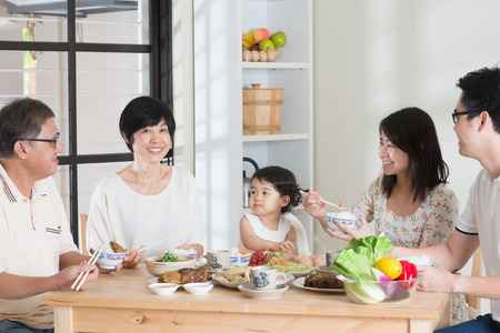 Photo pour Happy Asian Chinese multi generations family dining at home.  - image libre de droit