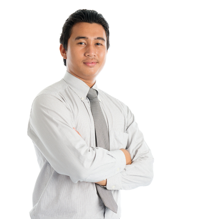 Photo pour Portrait of cool Southeast Asian businessman arms crossed, standing isolated on white background. - image libre de droit