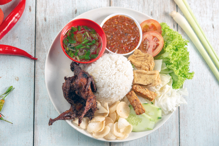 Photo for Nasi lemak kukus with quail meat, popular traditional Malaysian local food. Flat lay top down overhead view. - Royalty Free Image