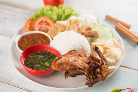 Photo for Nasi lemak kukus with fried chicken, popular traditional Malaysian local food. - Royalty Free Image