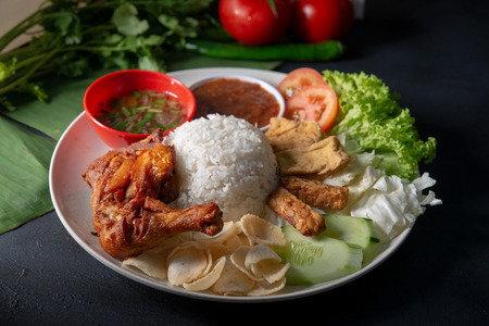 Photo for Nasi lemak kukus with fried drumstick, popular traditional Malaysian local food. - Royalty Free Image