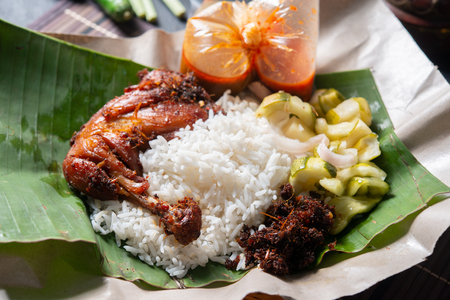 Photo for Nasi lemak kukus with chicken, popular traditional Malay local food. - Royalty Free Image