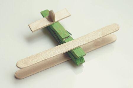 Photo pour Child artwork, ice cream stick made plane on plain background. - image libre de droit