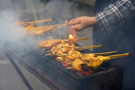 Photo for Malaysian traditional dishes, popular grilled spiced chicken Ayam Percik selling in Bazaar during the holy month of Ramadan. - Royalty Free Image