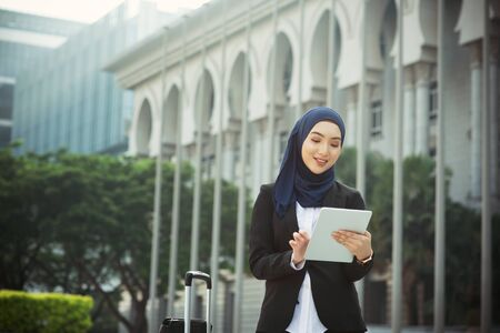 Photo pour Muslim woman working on table pc outdoor, business travel concept. - image libre de droit