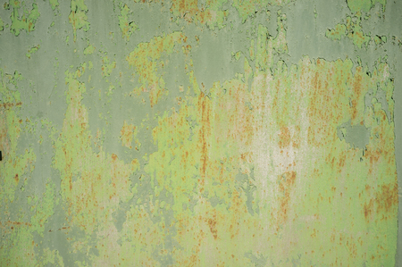 Photo pour Detail of Old, Grunge, Rusty Metal Doors with Layers of Green, Turquoise and Yellow Paint and Rust - image libre de droit