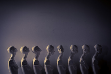 Foto per Plastic Woman Mannequins Standing in The Line, With One Looking to Another Direction then the Others in Melancholic Mood - Immagine Royalty Free