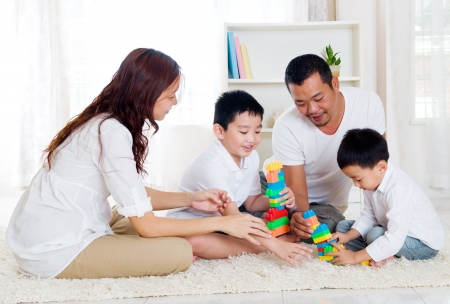 Photo for Asian family playing building blocks - Royalty Free Image
