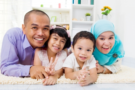 Photo for muslim family lying on the floor - Royalty Free Image