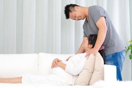 Photo pour Asian man talking with his pregnant wife - image libre de droit