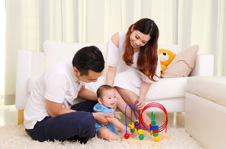 Photo for Asian parent playing with their six months old baby boy - Royalty Free Image