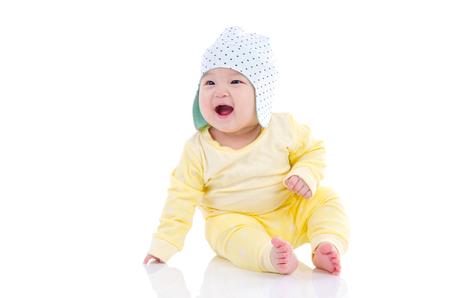 Photo pour Asian baby sitting on the floor and laugh - image libre de droit