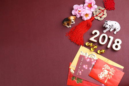 Foto de Miniature dogs with chinese new year decorations for year 2018 - Imagen libre de derechos