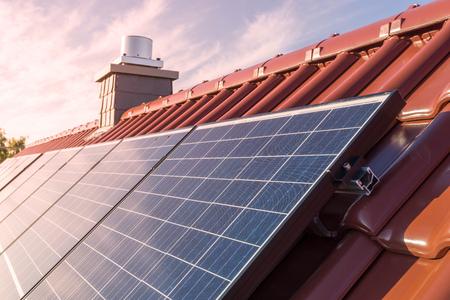 Photo pour Solar panels or photovoltaic power plant on the roof of a house - image libre de droit