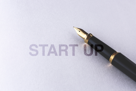 Foto de notebook and fountain pen on white background - Imagen libre de derechos