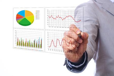 Foto de Asian businessman pointing at business chart - Imagen libre de derechos