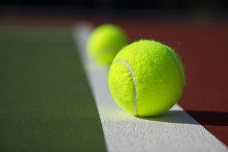 New Tennis Balls shot on  a brand new outdoor tennis court