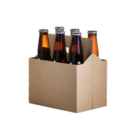 Photo pour Angled view of a six pack of glass bottled beer in generic brown cardboard carrier isolated on white background - image libre de droit