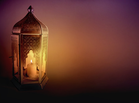 Photo for Ornamental Arabic lantern with burning candle glowing at night. Greeting card, invitation for Muslim community holy month Ramadan Kareem. Dark background with a lot of empty space. - Royalty Free Image