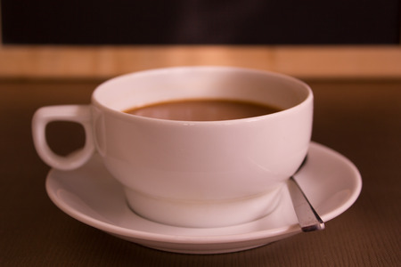 cup of hot coffee in coffee shop.