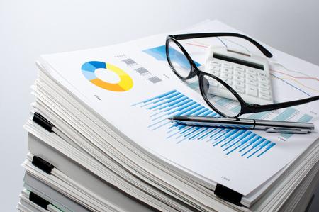 Photo pour Data management. Document management... Business concept. Pile of documents on gray background. Graph, glasses, calculate and pen. - image libre de droit
