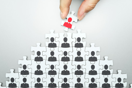 Foto de Selecting leader of business organization. Human resource management... Head hunting. Assembling jigsaw puzzle. Organizing business people hierarchy. - Imagen libre de derechos