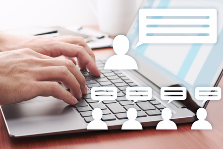 Photo pour Internet communication concept. Man posting messages on social media. Laptop and person icons. - image libre de droit