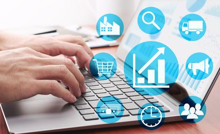 Foto de Enterprise resource planning concept. Businessman analyzing data. Many graphs and charts on laptop display. Business management icons. - Imagen libre de derechos