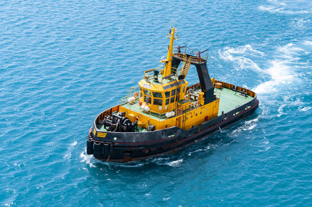 Photo for Cruising escort ship at sea. Top view of pilotage service boat cruising into harbor. - Royalty Free Image
