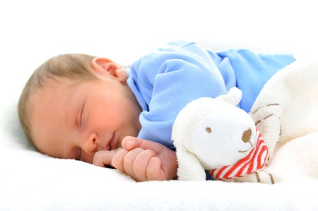 Photo for cute baby with toy sleeping on white blanket - Royalty Free Image