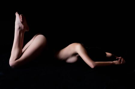woman lying down with curved line of her body, grain added