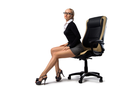 Photo for Sexy blonde secretary with perfect legs sitting in the office chair - isolated on the white. - Royalty Free Image