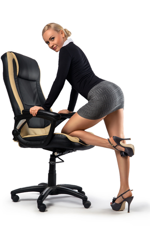 Photo for Sexy blonde secretary with perfect legs posing with the office chair - isolated on the white. - Royalty Free Image