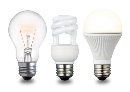 Foto de Compact fluorescent lamp, incandescent lightbulb and LED lightbulb in ascending chronological order. Isolated on a white background. - Imagen libre de derechos