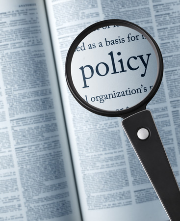 Photo pour PolicyMagnifying glass on the policy in dictionary - image libre de droit