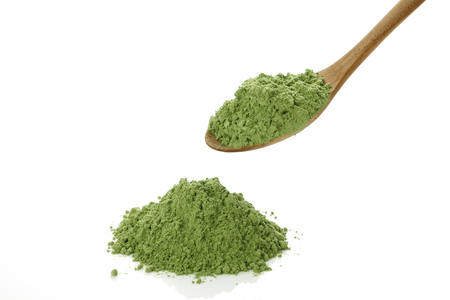 Photo for Green juice powder on spoon - Royalty Free Image
