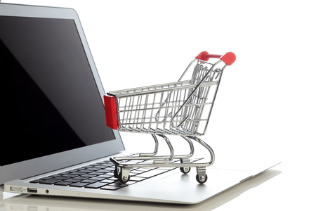 Photo for E-commerce. Shopping cart on laptop. Conceptual image. - Royalty Free Image