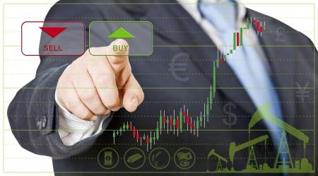Foto de businessman opens a long position by clicking on buy - Imagen libre de derechos