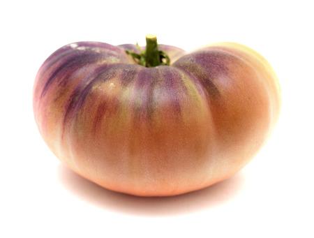 Foto de single unripe blue tomato isolated on white background - Imagen libre de derechos
