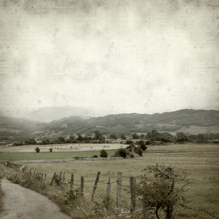 Photo pour textured old paper background with rural landscapes of Cantabria, North of Spain - image libre de droit