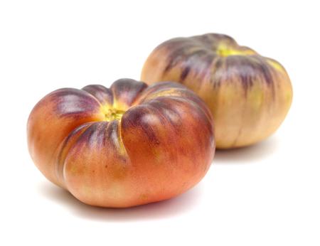 Foto de large unripe blue tomatoes isolated on white background - Imagen libre de derechos
