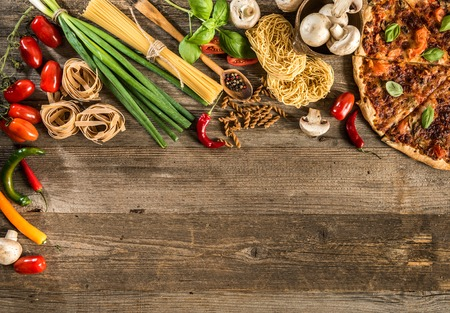 Photo for Italian food background with pizza, raw pasta and vegetables on wooden table - Royalty Free Image