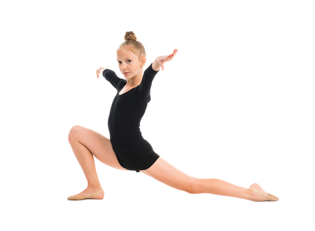 Photo pour little gymnast stretching on the floor isolated on white background - image libre de droit