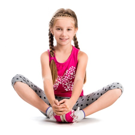 Photo for little girl doing yoga isolated on white background - Royalty Free Image