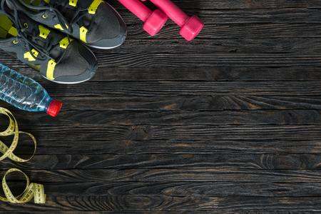 Foto de sport fitness items on dark wooden background with empty text space - Imagen libre de derechos
