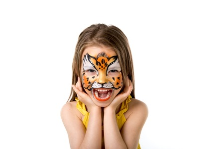 Photo pour cute little girl with colorful painted face like tiger - image libre de droit