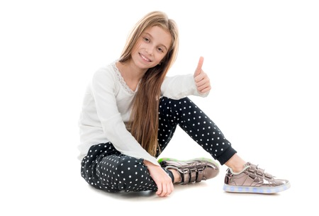 smiling teenage girl sitting on the floor