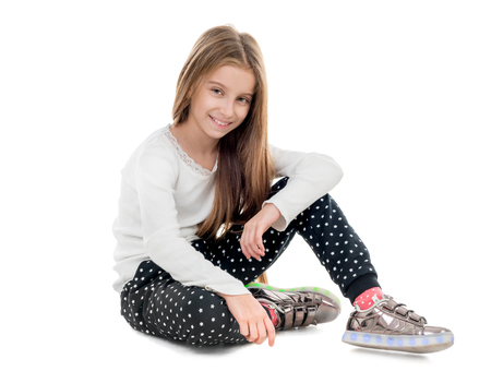 Photo for smiling teenage girl sitting on the floor - Royalty Free Image