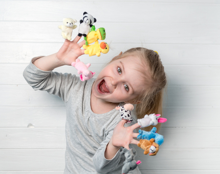 Photo for girl with doll puppets on her hands - Royalty Free Image