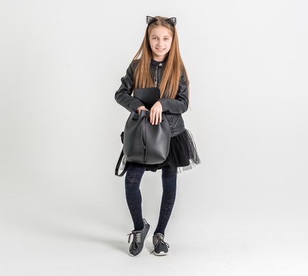Photo for Fashionable teenage girl in a black jacket - Royalty Free Image